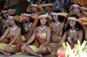 Dancers wait before performing for French President in Papeete, the capital of the French Polynesian island of Tahiti, on February 22, 2016, during a two-day visit. / AFP / STEPHANE DE SAKUTIN        (Photo credit should read STEPHANE DE SAKUTIN/AFP/Getty Images)